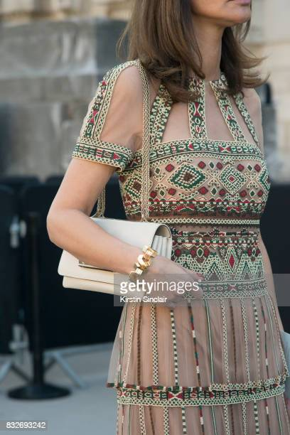A guest wears an embroidred dress day 2 of Paris Haute Couture Fashion Week Autumn/Winter 2017 on July 3 2017 in Paris France