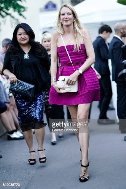 A guest wears an offshoulder purple ruffle dress outside the launch party for Chanel's new perfume 'Gabrielle' during Paris Fashion Week Haute...