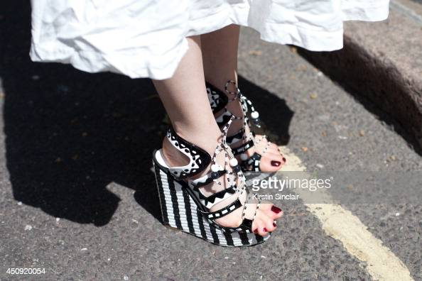 A guest wears black and white wedge sandals on day 3 of London Collections Men on June 17 2014 in London England