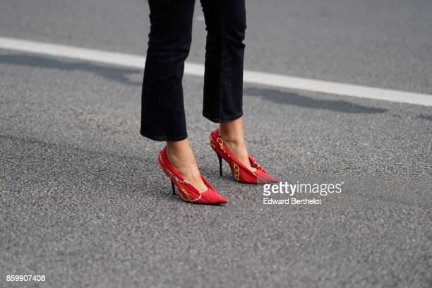 A guest wears black flare pants red and yellow stilettos outside the Dries Van Noten show during Paris Fashion Week Womenswear Spring/Summer 2018 on...