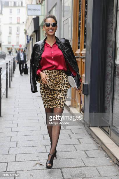 A guest wears Dolce and Gabbana jacket Zara skirt Yves Saint Laurent purse and Dsquared sunglasses before the AF Vandervorst Haute Couture fashion...