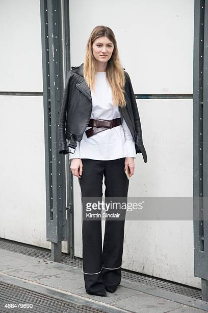 A guest wears Fall Winter Spring Summer jacket Trademan shirt Cos belt Proenza Schouler shoes and Urdam trousers on day 7 of Paris Collections Women...