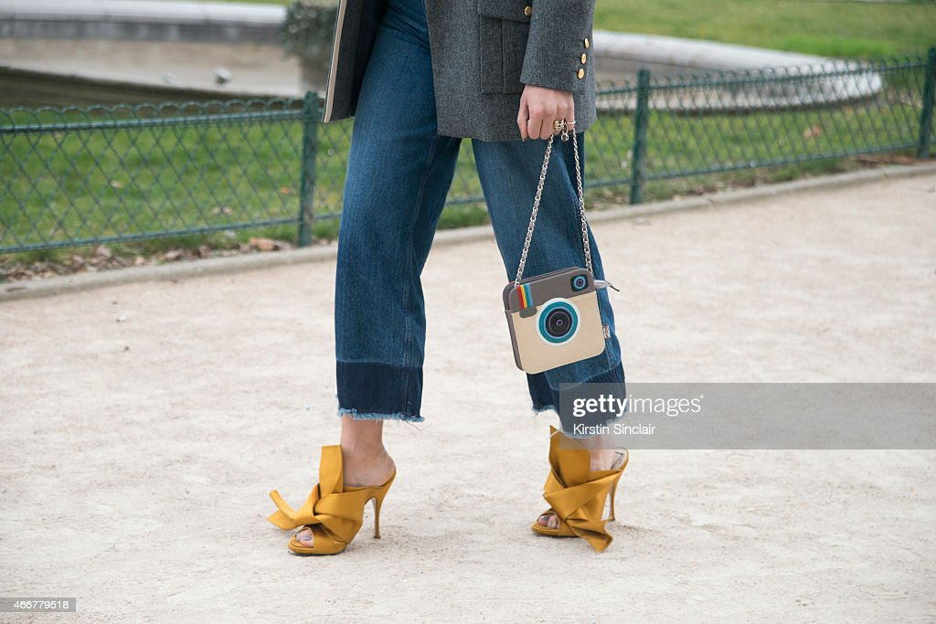 A guest wears H and M jeans Christian Dior shoes and Krukru bag on day 8 of Paris Collections Women on March 10 2015 in Paris France