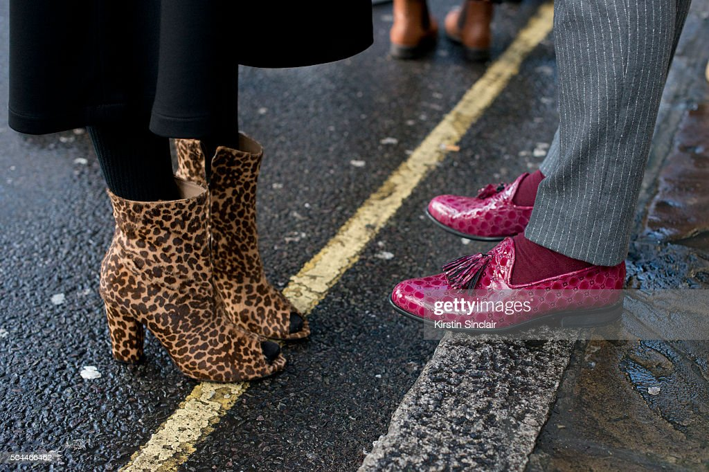 A guest wears leopard print peep toe ankle boot with a guest who wears pink loafers on day 1 of London Collections Men on Januay 8 2016 in London...