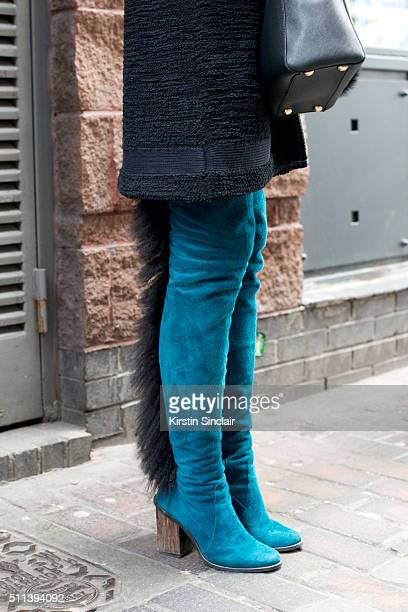 A guest wears Saz boots on day 1 during London Fashion Week Autumn/Winter 2016/17 on February 19 2016 in London England