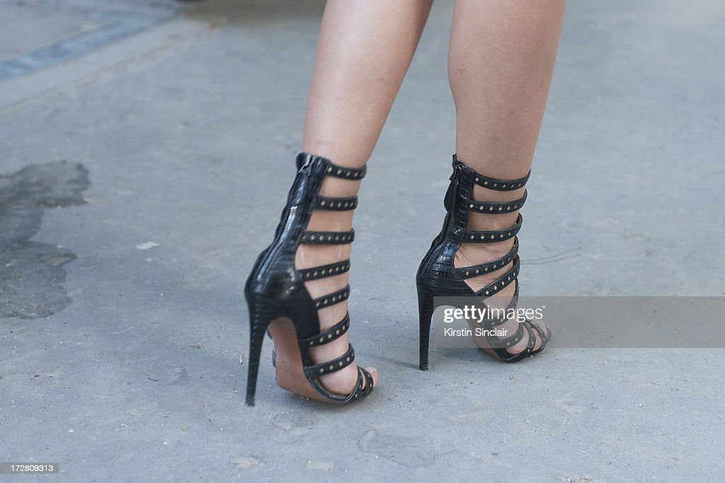 A guest wears strappy, studded shoes on day 1 of Paris Collections: Womens Haute Couture on July 01, 2013 in Paris, France.