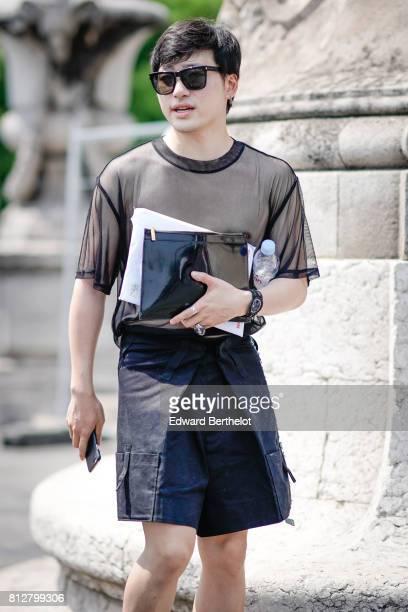 A guest wears sunglasses a black mesh tshirt black shorts a black leather bag outside the Icosae show during Paris Fashion Week Menswear...