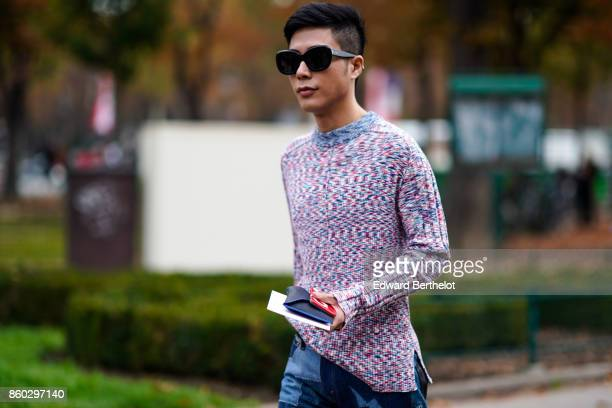 A guest wears sunglasses a blue and pink marled pullover outside Lanvin during Paris Fashion Week Womenswear Spring/Summer 2018 on September 27 2017...