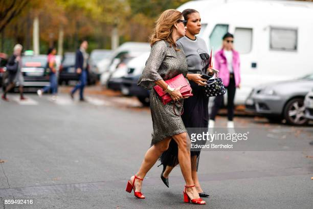 A guest wears sunglasses a grey lame dress red bag and red sandals a guest wears a grey pullover a long black skirt a LV Vuitton bag and black...