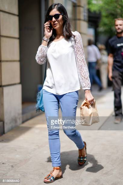 A guest wears sunglasses a white top blue pants colored sandals a jacket outside the Elie Saab show during Paris Fashion Week Haute Couture...
