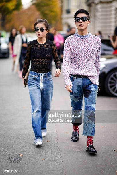 A guest wears sunglasses black lace top denim pants with a large zip and white shoes a guest wears sunglasses a marled pink pullover blue denim...