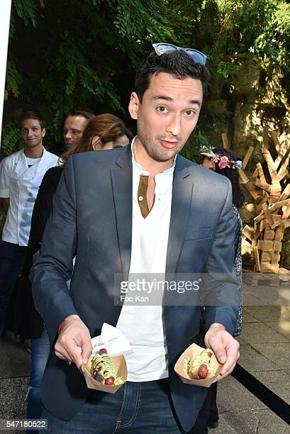 A guest with Chef David Azoulay merguez hot dogs attends the 'La Cafete Nationale' by Le Fooding Auction Event to Benefit Children of Congo Bethanie...