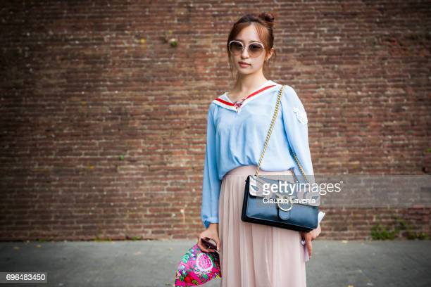 Guest with Hermes sandals and Pinko bag is seen during Pitti Immagine Uomo 92 at Fortezza Da Basso on June 15 2017 in Florence Italy