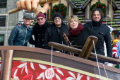 A guest with musicians Mike Malinin Robby Takac and John Rzeznik of the Goo Goo Dolls attend the 87th annual Macy's Thanksgiving Day parade on...