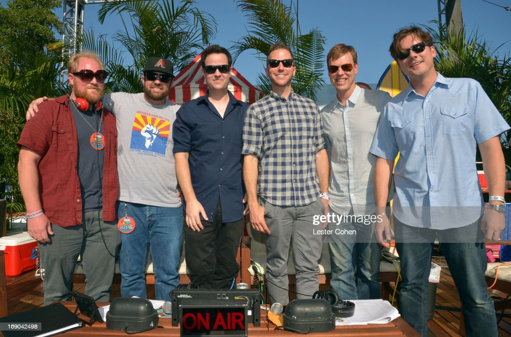 Guest, Zach Lind, Tom Linton, DJ Stryker, Rich Burch and Jim Adkins of Jimmy Eat World backstage during KROQ Weenie Roast Y Fiesta at Verizon Wireless Amphitheater on May 18, 2013 in Irvine, California.