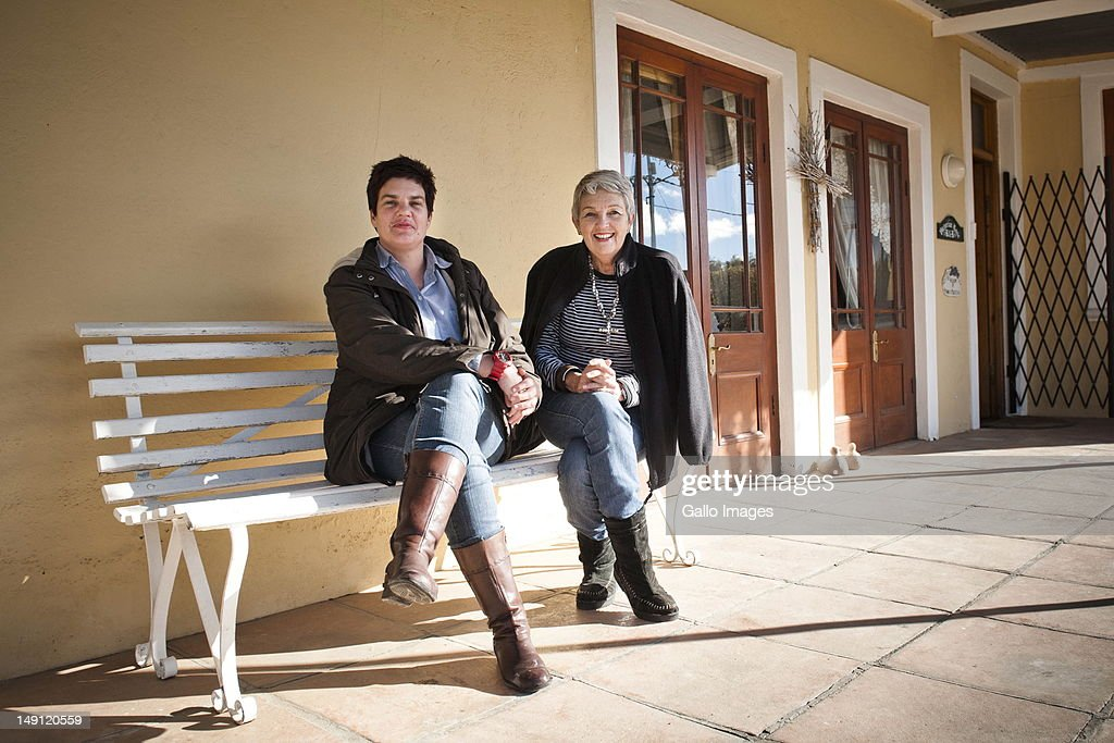 Guesthouse owners Lize-Mare Malan (L) and Magrieta Botha infront of their Victorian Rose Guesthouse on July 20, 2012 in Carnarvon in the Northern Cape, South Africa. The town, which has a population of 6000, is the home of the KAT-7 telescope and will host the Square Kilometre Array radio telescope. Due to these developments the town's economy is growing.