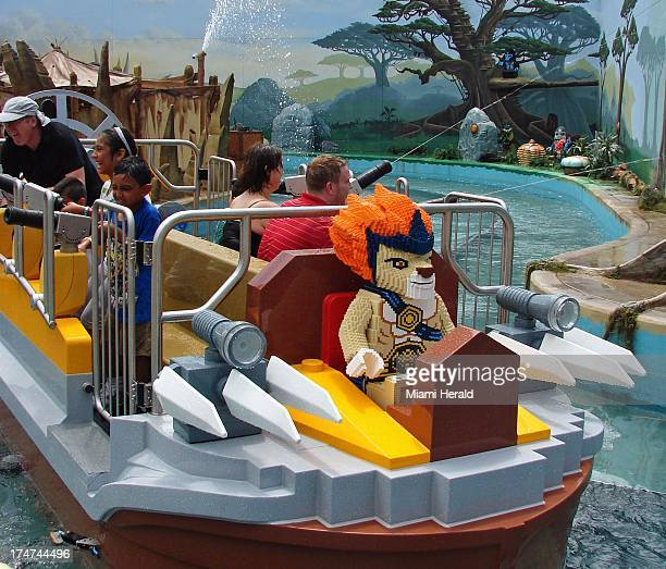 Guests aim water cannons as they participate in a ride at the World of Chima attraction at Legoland in Orlando Florida