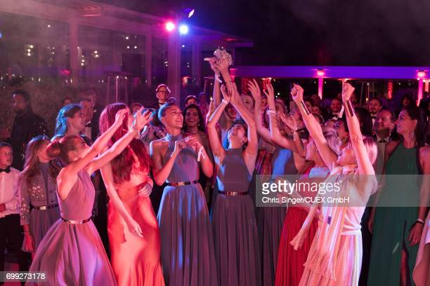 Guests and bridemaids try to catch the bridal bouquet during the wedding of Victoria Swarovski and Werner Muerz on June 16 2017 in Trieste Italy