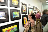 Guests and fans attend Peter Max A Retrospective 19602015 at Music City Fine Art on May 16 2015 in Nashville Tennessee