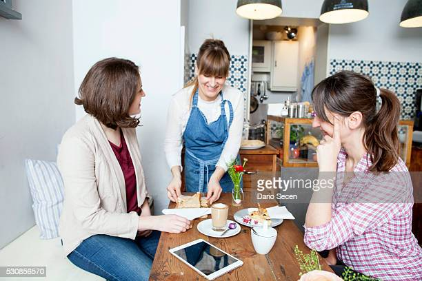 Guests and waitress in coffee shop