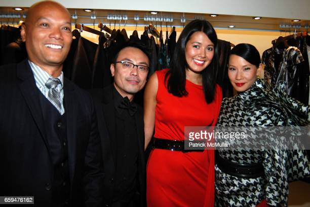 Guests Andrea Raspanti and Lucy Liu attend ALEXANDER MCQUEEN Fashion's Night Out at Alexander McQueen Store on September 10 2009 in New York