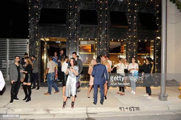 Guests appear in front of Vagu during the cocktail reception at Vagu on December 7 2017 in Miami Florida
