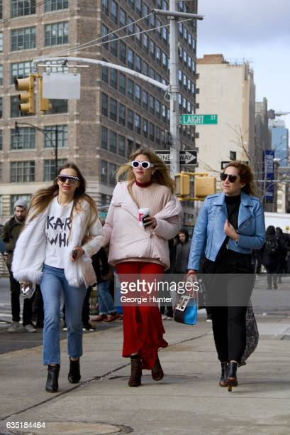 Guests are seen at Spring Studios outside the Phillip Lim show left wearing white faux fur coat with clear plastic rain jacket with hood white print...