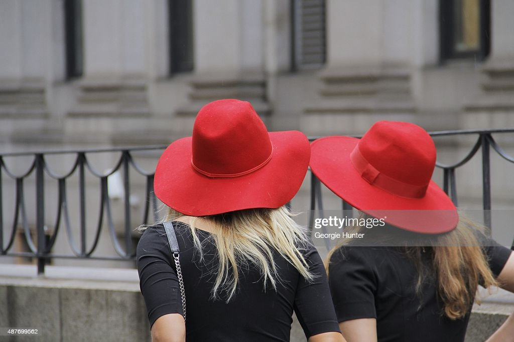 Guests are seen on the streets of Manhattan outside of the Erin Fetherston Spring Summer 2016 fashion show at Skylight at Moynihan Station wearing...