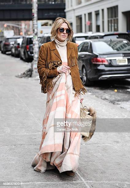 Guests are seen outside the Donna Karan show on February 16 2015 in New York City