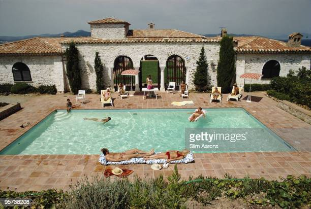 Guests around the pool at a villa in St Tropez France circa 1970