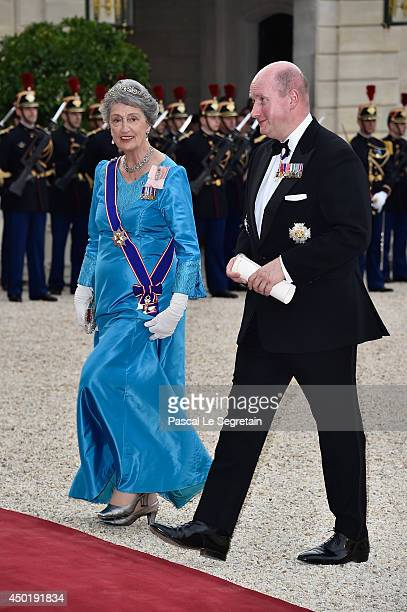 Guests arrive at the Elysee Palace for a State dinner in honor of Queen Elizabeth II hosted by French President Francois Hollande as part of a three...