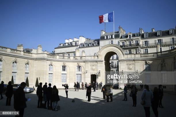Guests arrive at the Elysee Presidential Palace to attend an event dedicated to apprenticeship in public services on February 13 2017 in Paris / AFP...