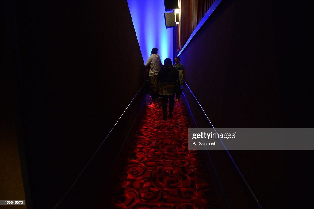 Guests arrive into theater XD before the reopening and remembrance of the Century Aurora Theater. James Holmes is accused of killing 12 people and wounding 70 others on July 20, 2012 in theater 9.