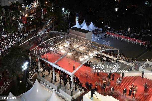 TOPSHOT Guests arrive on May 18 2017 for the screening of the film 'Blade of the Immortal' at the 70th edition of the Cannes Film Festival in Cannes...