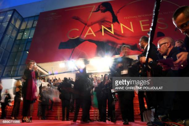 Guests arrive on May 27 2017 for the screening of the film 'You Were Never Really Here' at the 70th edition of the Cannes Film Festival in Cannes...