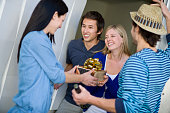 Guests Arriving with Gifts at Friend's House