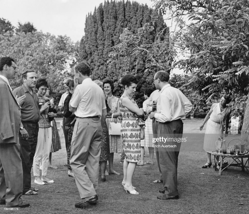 Guests at a garden party given by English composer <a gi-track='captionPersonalityLinkClicked' href=/galleries/search?phrase=Benjamin+Britten&family=editorial&specificpeople=213314 ng-click='$event.stopPropagation()'>Benjamin Britten</a> (1913 - 1976, centre, left) at his home in Aldburgh, Suffolk, 1st July 1961. Among the guests are Welsh harpist and composer Osian Ellis (far left), cellist Terence Weil (1921 - 1995, second from left), Marion, Countess of Harewood (background, centre) and Russian operatic soprano <a gi-track='captionPersonalityLinkClicked' href=/galleries/search?phrase=Galina+Vishnevskaya&family=editorial&specificpeople=911029 ng-click='$event.stopPropagation()'>Galina Vishnevskaya</a> (centre, right) with her husband, cellist <a gi-track='captionPersonalityLinkClicked' href=/galleries/search?phrase=Mstislav+Rostropovich&family=editorial&specificpeople=214711 ng-click='$event.stopPropagation()'>Mstislav Rostropovich</a> (1927 - 2007).