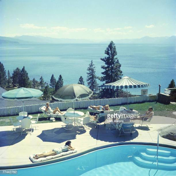 A group of people relaxing by a pool near Lake Tahoe California 1959