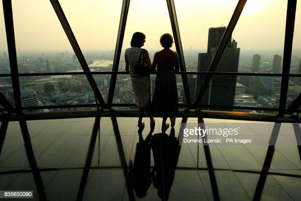 Guests at Richard BalfourLynn's AHG AND MWB Group and Variety Club Children's Charity Party look across London from the top of the Swiss Re building...