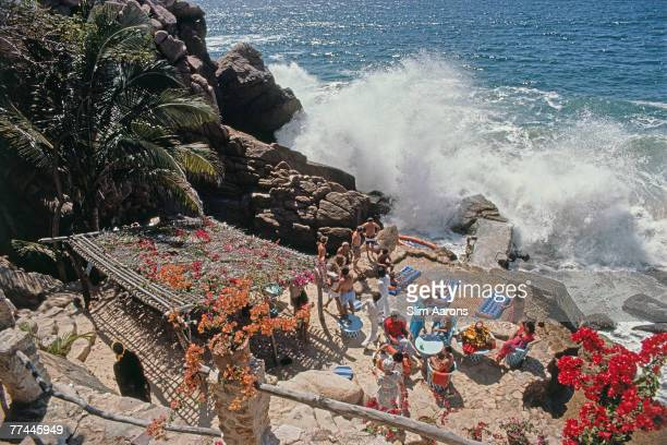 Guests at the beachside Casa Las Estacas home of Milton and Gloria Gunzburg in Puerto Vallarta Mexico 1979