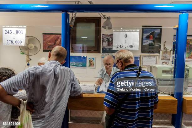 Guests at the entrance to the Caritas canteen at Colle Oppio in Rome on the midAugust holiday on August 15 2017 in Rome Italy Caritas canteen of...