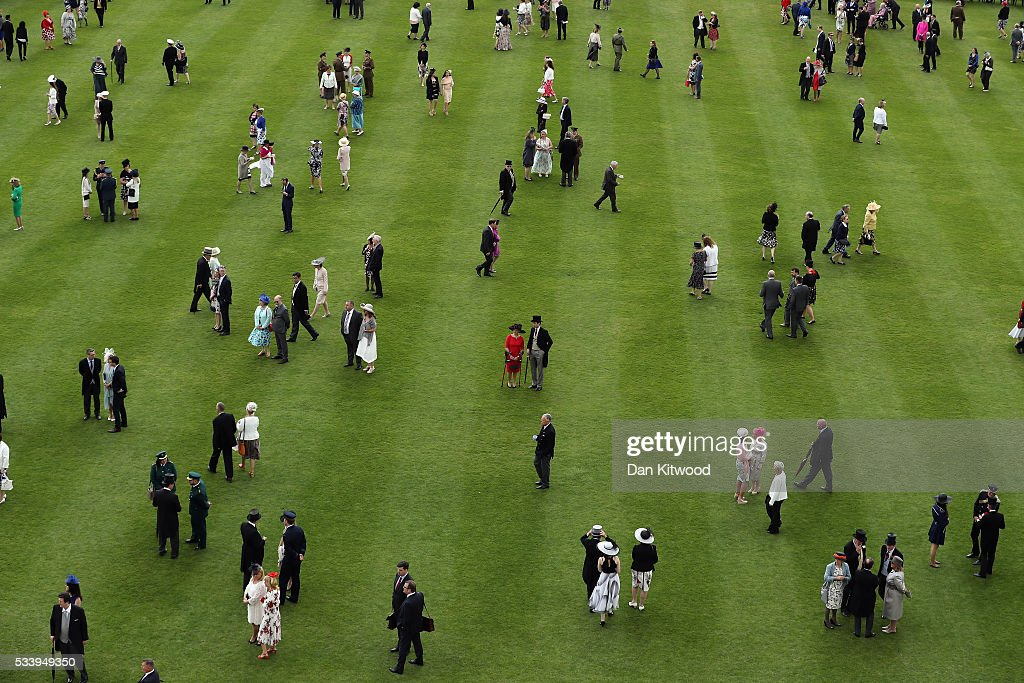 Guests attend a garden party at Buckingham Palace on May 24, 2016 in London, England.