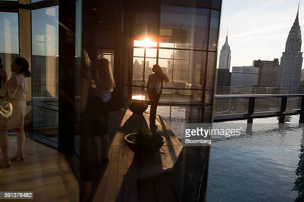Guests attend a pool party in the penthouse apartment at the 50 United Nations Plaza building in New York US on Tuesday June 7 2016 About 3574 newly...