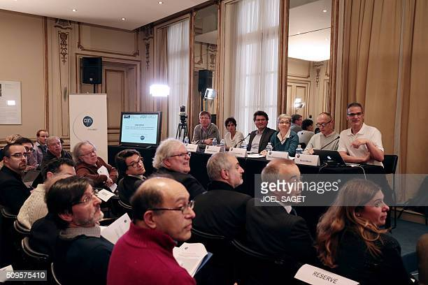 Guests attend a press briefing of the CNRS on gravitational wave research by LIGO and VIRGO collaborations in Paris on February 11 2016 In a landmark...