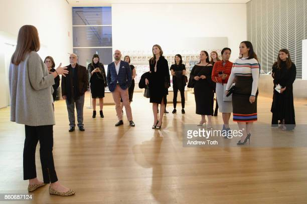 Guests attend as Harper's BAZAAR and THE OUTNETCOM Celebrate the opening of MoMA's Fashion Exhibit 'Is Fashion Modern' at MOMA on October 12 2017 in...