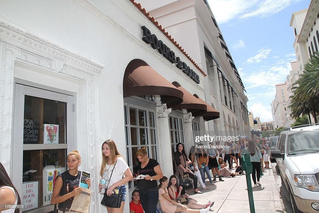 Guests attend as Pattie Mallett signs copies of her book 'Nowhere But Up' at Books and Books on July 12, 2013 in Coral Gables, Florida.
