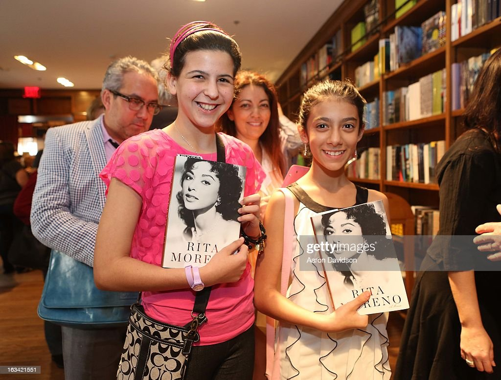 Guests attend as Rita Moreno greets fans and signs copies of her book 'Rita Moreno: A Memoir' at Books and Books on March 9, 2013 in Coral Gables, Florida.