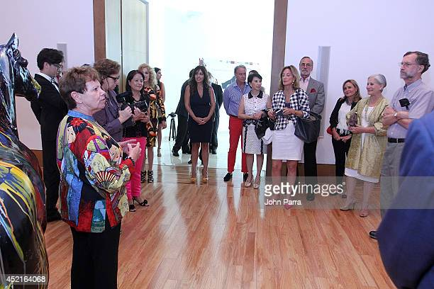Guests attend gallery tour given by Dr Carol Damian of Simon Ma's World Tour Exhibition 'Heart Water Ink' US Premiere At The Patricia And Phillip at...