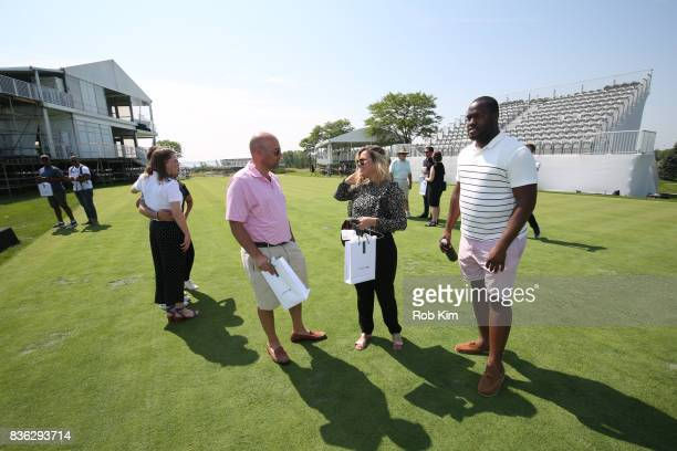 Guests attend LACOSTE 'Official Apparel Provider' unveiling during 2017 Presidents Cup Media Day at Liberty National Golf Club on August 21 2017 in...