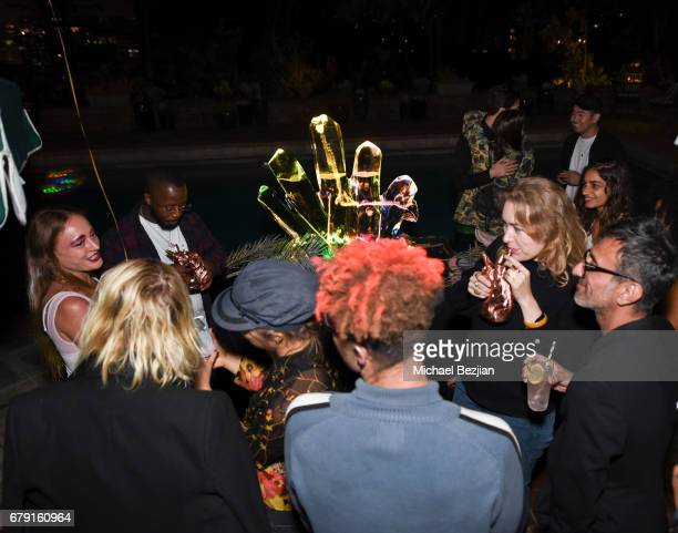 Guests attend Millie Brown's Rainbow Bodied Cocktail Event at the Private Residence of Jonas Tahlin CEO Absolut Elyx on May 4 2017 in Los Angeles...
